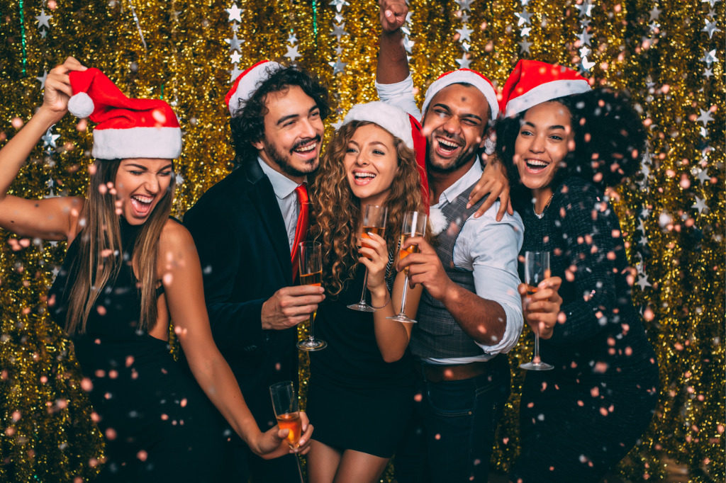 A photo of coworkers at a corporate christmas party