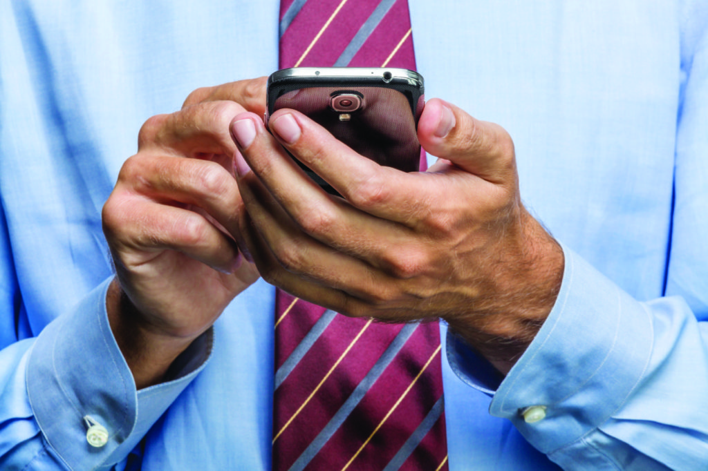 Businessman holding a smartphone
